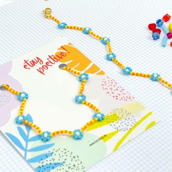 """Armband """"Itsybitsy Flower"""" (hellblau/gelb/orange)"""